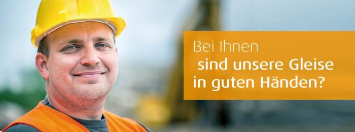 Bild mit Gleisbauer und Text: Bei Ihnen sind unsere Gleise in guten Händen?